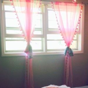 Tasseled sheer pink and white curtain panels